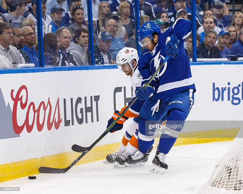 Jonathan Marchessault #81 of the Tampa Bay Lightning battles for the puck against Thomas Hickey #14 of the New York Islanders during the first period of Game Two of the Eastern Conference Second Round in the 2016 NHL Stanley Cup Playoffs at the Amalie Arena on April 30, 2016 in Tampa, Florida.