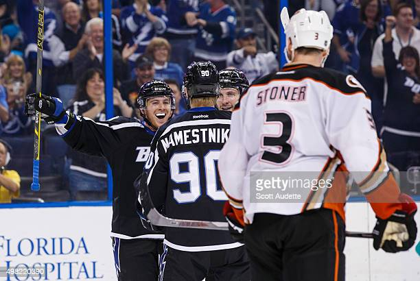 Jonathan Marchessault of the Tampa Bay Lightning celebrates his goal with Vladislav Namestnikov and Nikita Kucherov against Clayton Stoner and the...