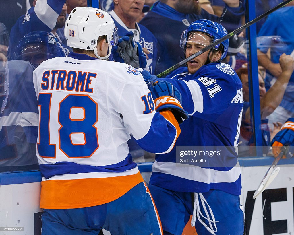 Jonathan Marchessault #81 of the Tampa Bay Lightning pushes <a gi-track='captionPersonalityLinkClicked' href=/galleries/search?phrase=Ryan+Strome&family=editorial&specificpeople=6381535 ng-click='$event.stopPropagation()'>Ryan Strome</a> #18 of the New York Islanders during the third period of Game Two of the Eastern Conference Second Round in the 2016 NHL Stanley Cup Playoffs at the Amalie Arena on April 30, 2016 in Tampa, Florida.