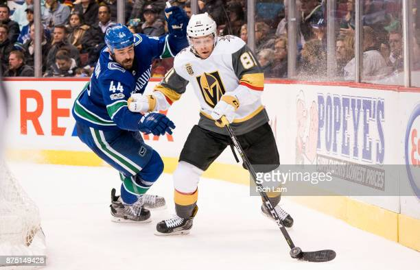 Jonathan Marchessault of the Vegas Golden Knights tries to break free from the check of Erik Gudbranson of the Vancouver Canucks in NHL action on...