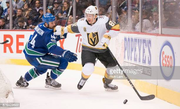 Jonathan Marchessault of the Vegas Golden Knights tries to get past Erik Gudbranson of the Vancouver Canucks in NHL action on November 2017 at Rogers...