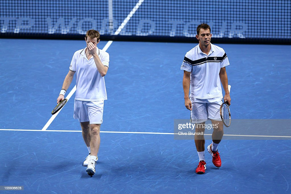 Jonathan Marray of Great Britain and Frederik Nielsen of Denmark reacts during their men's doubles match against Robert Lindstedt of Sweden and Horia...