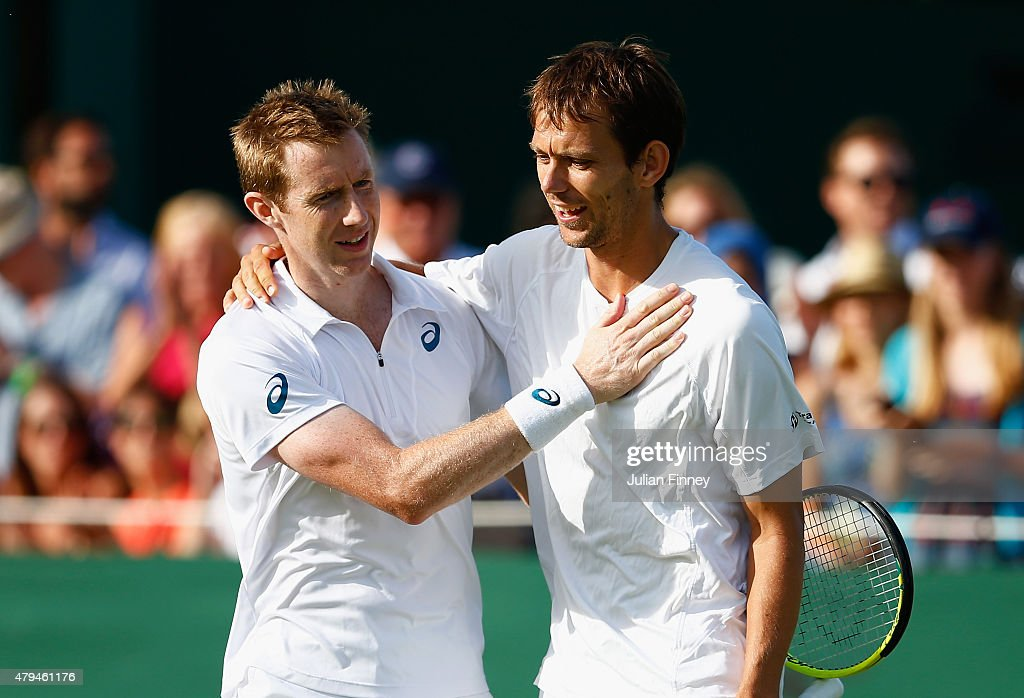 Jonathan Marray of Great Britain and Frederik Nielsen of Denmark celebrate during the Gentlemens Doubles Second Round match against JuanSebastian...