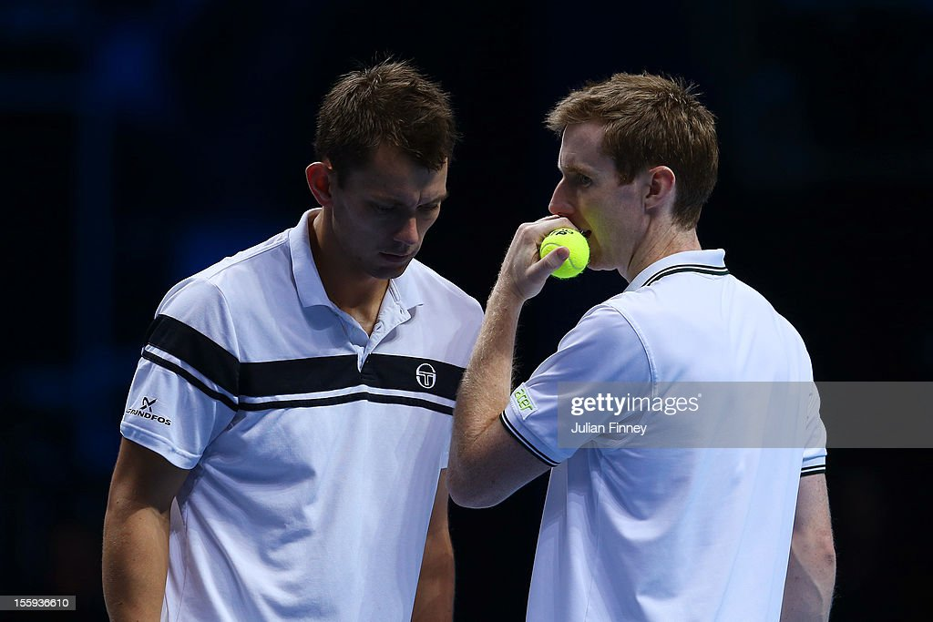 Jonathan Marray of Great Britain talks tactics with Frederik Nielsen of Denmark during their men's doubles match against Robert Lindstedt of Sweden...