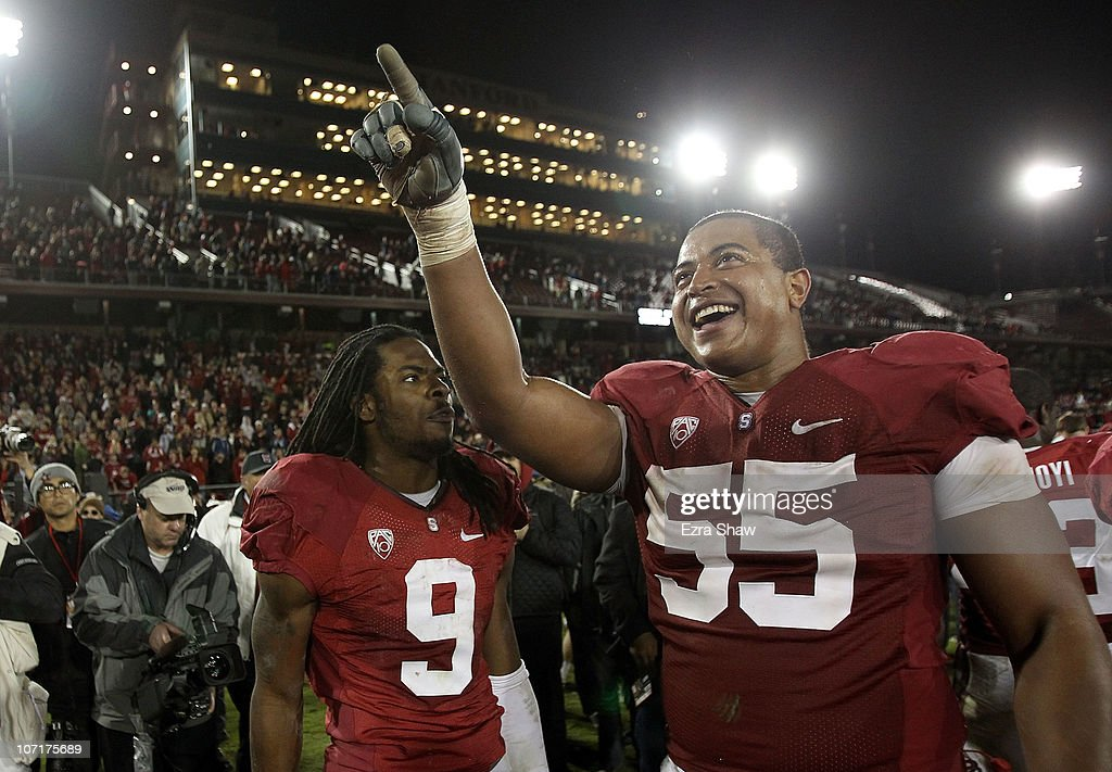 Jonathan Martin #55 and Richard Sherman #9 of the Stanford Cardinal celebrate after they beat the Oregon State Beavers at Stanford Stadium on November 27, 2010 in Palo Alto, California.