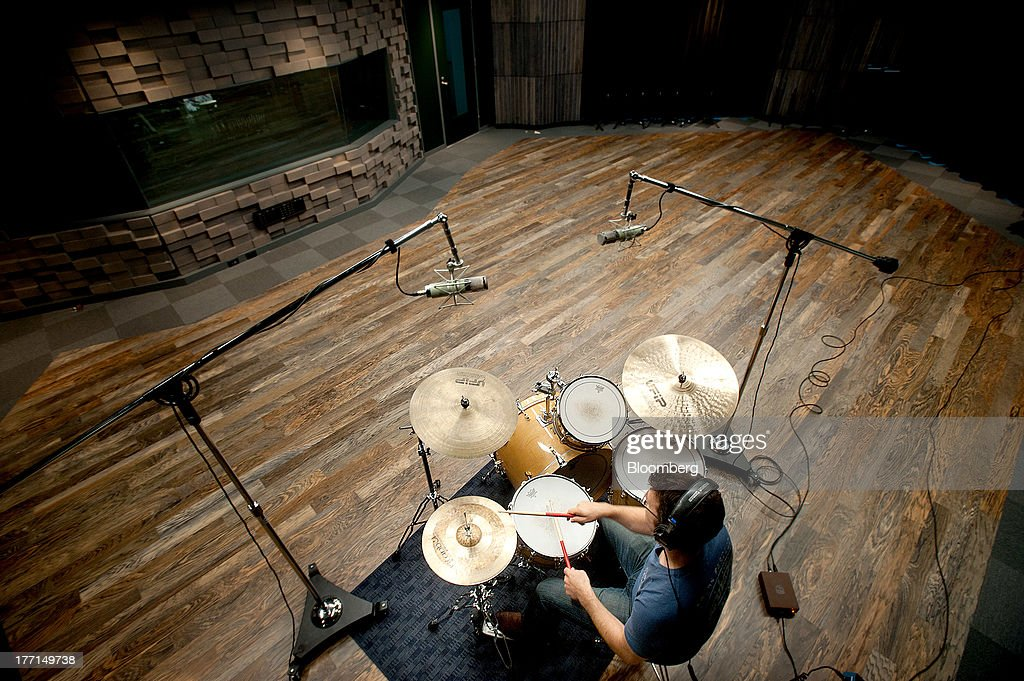 Jonathan Mayer, senior music manager, plays drums while setting up a recording room at Sony Computer Entertainment America's headquarters in San Mateo, California, U.S., on Tuesday, Aug. 20, 2013. Sony Corp. will start selling the PlayStation 4 in North America on Nov. 15, moving to obtain an early advantage in the largest video-game market against Microsoft Corp. Photographer: Noah Berger/Bloomberg via Getty Images
