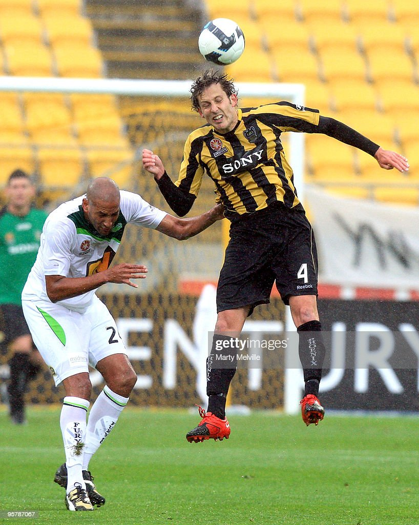 Jonathan McKain of the Phoenix jumps for the ball with Dyron Daal of the Fury during the round 23 A-League match between the Wellington Phoenix and North Queensland Fury at Westpac Stadium on January 15, 2010 in Wellington, New Zealand.