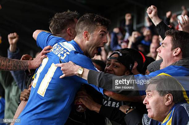 Jonathan Meades of AFC Wimbledon celebrates with fans after Gary Alexander of AFC Wimbledon opened the scoring during the npower League Two match...