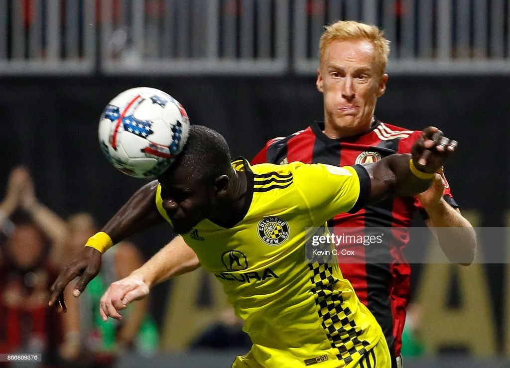 Jonathan Mensah #4 of Columbus Crew defends a shot in front of Jeff Larentowicz #18 of Atlanta United during the Eastern Conference knockout round at Mercedes-Benz Stadium on October 26, 2017 in Atlanta, Georgia.