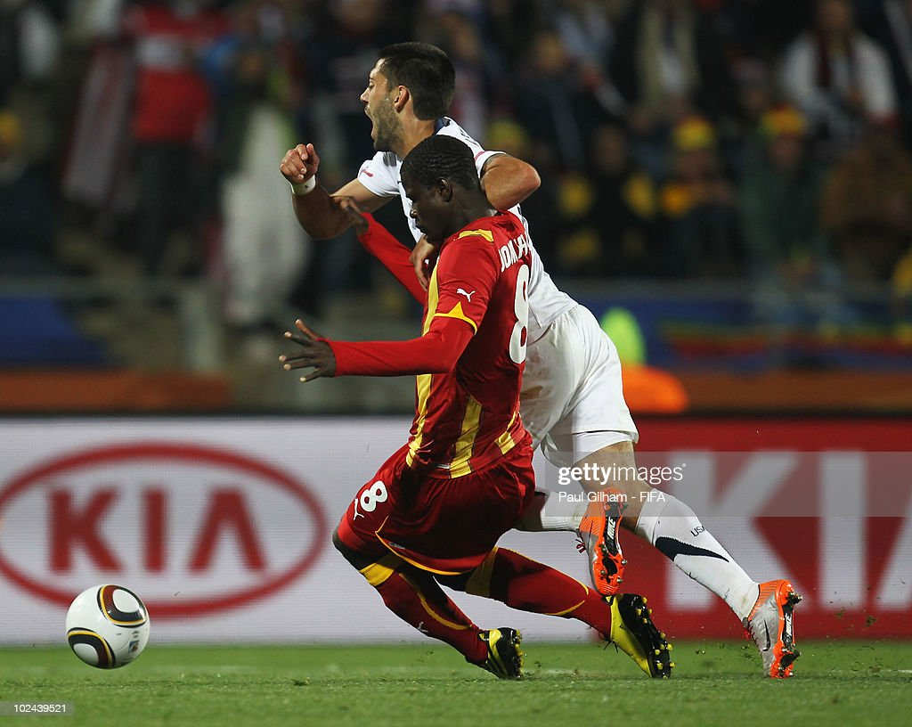 Jonathan Mensah of Ghana tackles <a gi-track='captionPersonalityLinkClicked' href=/galleries/search?phrase=Clint+Dempsey&family=editorial&specificpeople=547866 ng-click='$event.stopPropagation()'>Clint Dempsey</a> of the United States inside the penalty area and referee Viktor Kassai awards a penalty kick during the 2010 FIFA World Cup South Africa Round of Sixteen match between USA and Ghana at Royal Bafokeng Stadium on June 26, 2010 in Rustenburg, South Africa.