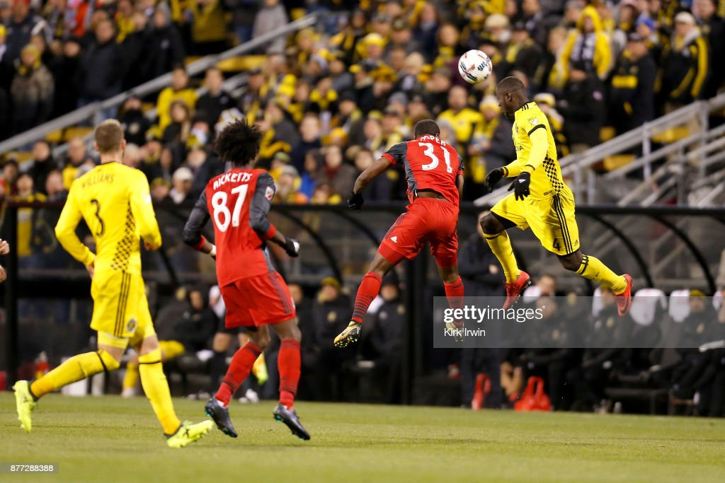 Jonathan Mensah #4 of the Columbus Crew SC clears the ball away from Armando Cooper #31 of the Toronto FC during the second half at MAPFRE Stadium on November 21, 2017 in Columbus, Ohio. Columbus tied Toronto 0-0.