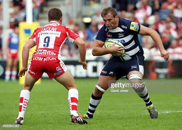 Jonathan Mills of Sale Sharks is confronted by Greig Laidlaw of Gloucester Rugby during the Aviva Premiership match between Gloucester Rugby and...