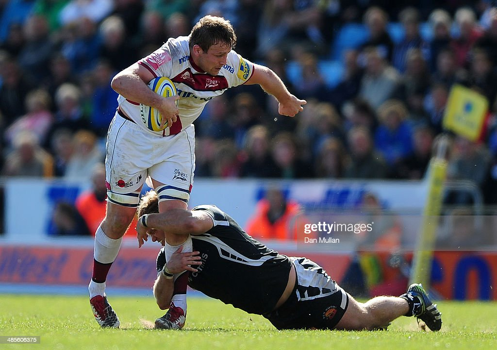 Jonathan Mills of Sale Sharks is tackled by Alex Brown of Exeter Chiefs during the Aviva Premiership match between Exeter Chiefs and Sale Sharks at...