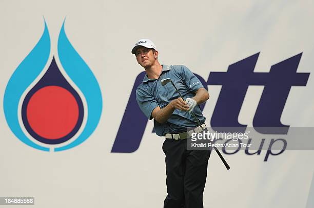 Jonathan Moore of USA plays a shot during round two of the Chiangmai Golf Classic at Alpine Golf ResortChiangmai on March 29 2013 in Chiang Mai...