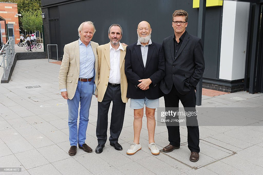 Jonathan Morrish, David Munns and Headmaster Stuart Worden, join Michael Eavis Glastonbury Festival Creator and recipient of the 2014 Music Industry Trusts Award (MITS) during his visit to the the BRIT School, one of the two charities alongside Nordoff Robbins that benefits from the MITS fundraising event, at The Brit School on September 25, 2014 in Croydon, England.
