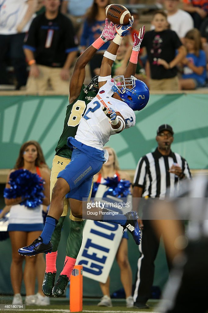 Jonathan Moxey of the Boise State Broncos defends on a pass intended for Xavier Williams of the Colorado State Rams and makes an interception in the...