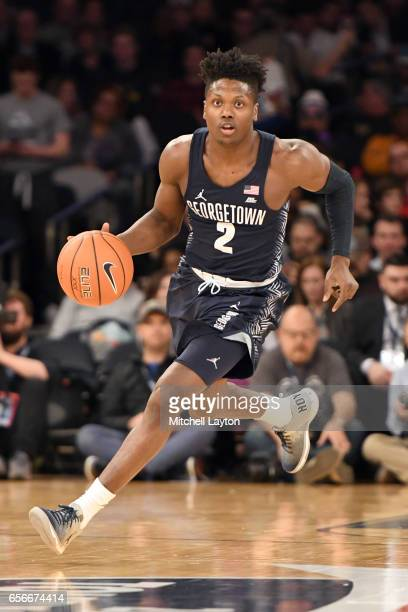 Jonathan Mulmore of the Georgetown Hoyas dribbles up court during the Big East Basketball Tournament First Round game against the St John's Red Storm...