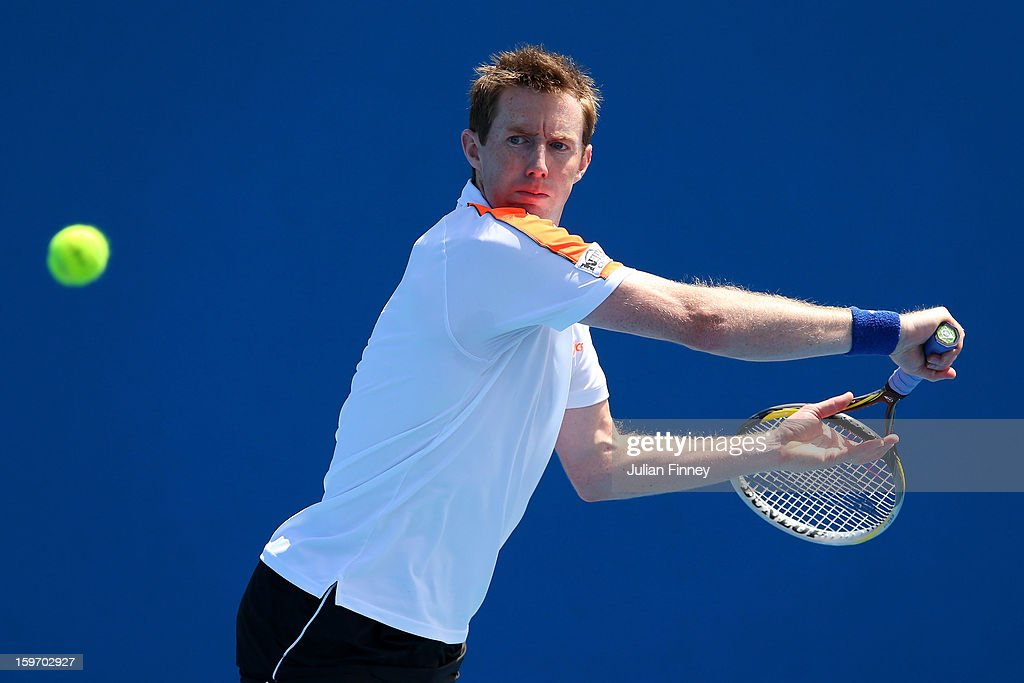 Jonathan Murray of Great Britain plays a backhand in his men's second round doubles match with Andre Sa of Brazil against Robin Haase of Netherlands and Igor Sijsling of Netherlands during day six of the 2013 Australian Open at Melbourne Park on January 19, 2013 in Melbourne, Australia.