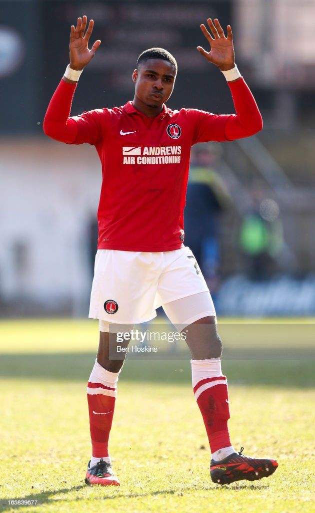 Jonathan Obika of Charlton shows his appreciation for the home support during the npower Championship match between Charlton Athletic and Leeds United at the Valley on April 06, 2013 in London, England.