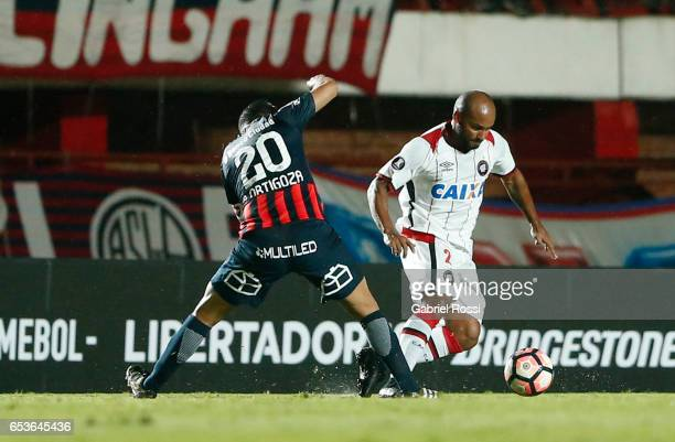 Jonathan of Atletico Paranaense fights for the ball with Nestor Ezequiel Ortigoza of San Lorenzo during a group stage match between San Lorenzo and...