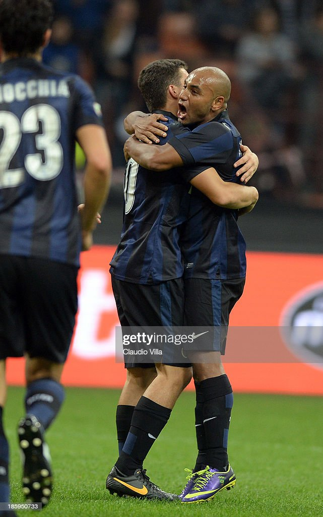 Jonathan of FC Inter Milan (R) and team-mate celebrate after their first goal is scored as an own goal by Hellas Verona FC during the Serie A match between FC Internazionale Milano and Hellas Verona at Stadio Giuseppe Meazza on October 26, 2013 in Milan, Italy.