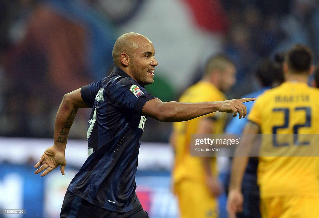 Jonathan of FC Inter Milan celebrates after his team's first goal is scored as an own goal by Hellas Verona FC during the Serie A match between FC Internazionale Milano and Hellas Verona at Stadio Giuseppe Meazza on October 26, 2013 in Milan, Italy.