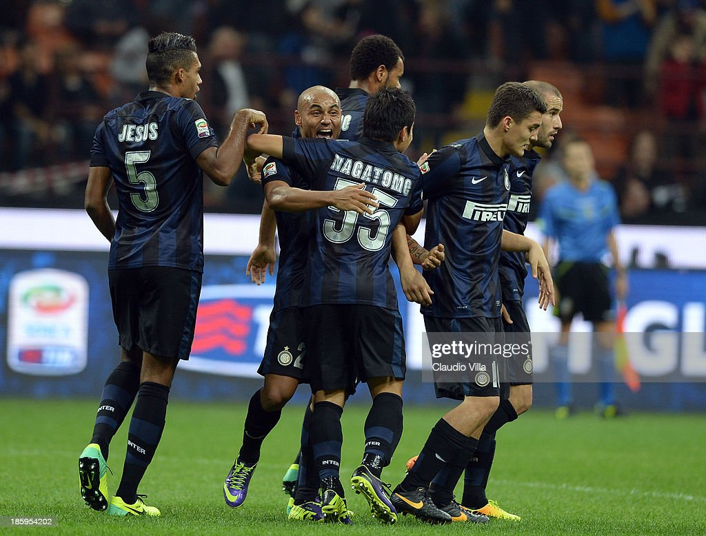Jonathan of FC Inter Milan (2nd L) celebrates with team-mates after their first goal is scored as an own goal by Hellas Verona FC during the Serie A match between FC Internazionale Milano and Hellas Verona at Stadio Giuseppe Meazza on October 26, 2013 in Milan, Italy.