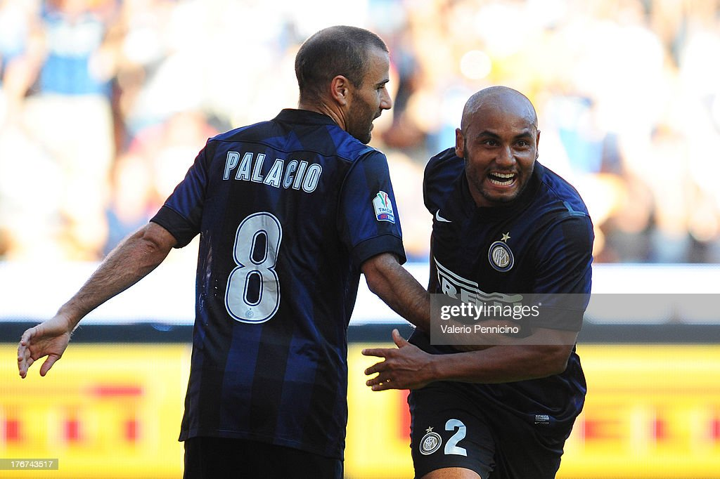 Jonathan (R) of FC Internazionale Milano celebrates the opening goal during the TIM cup match between FC Internazionale Milano and AS Cittadella at Stadio Giuseppe Meazza on August 18, 2013 in Milan, Italy.