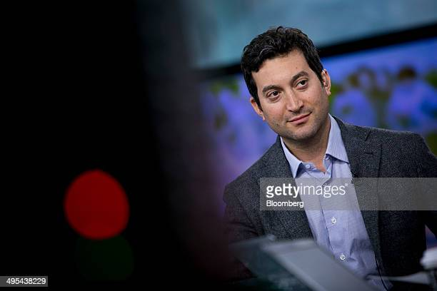 Jonathan Oringer chief executive officer of Shutterstock Inc listens to a question during a Bloomberg Television interview in New York US on Tuesday...