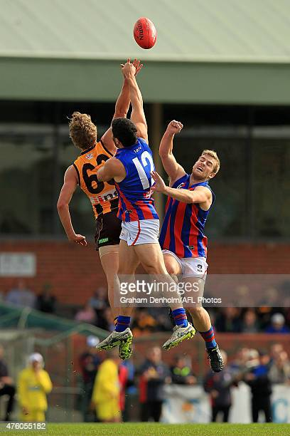 Jonathan O'Rourke of Box Hill competes in the air with Mitchell Wooffindin and Blake Pearson of Port Melbourne during the round eight VFL match...