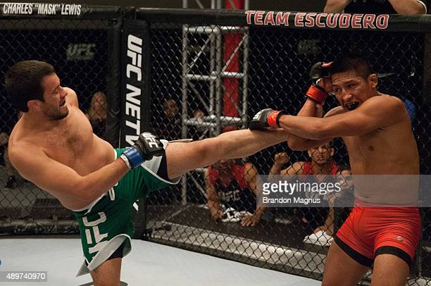 Jonathan Ortega kicks Enrique Barzola during the filming of The Ultimate Fighter Latin America Team Gastelum vs Team Escudero on April 7 2015 in Las...