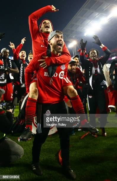 Jonathan Osorio and Sebastian Giovinco of Toronto FC celebrate after winning the 2017 MLS Cup Final against the Seattle Sounders at BMO Field on...