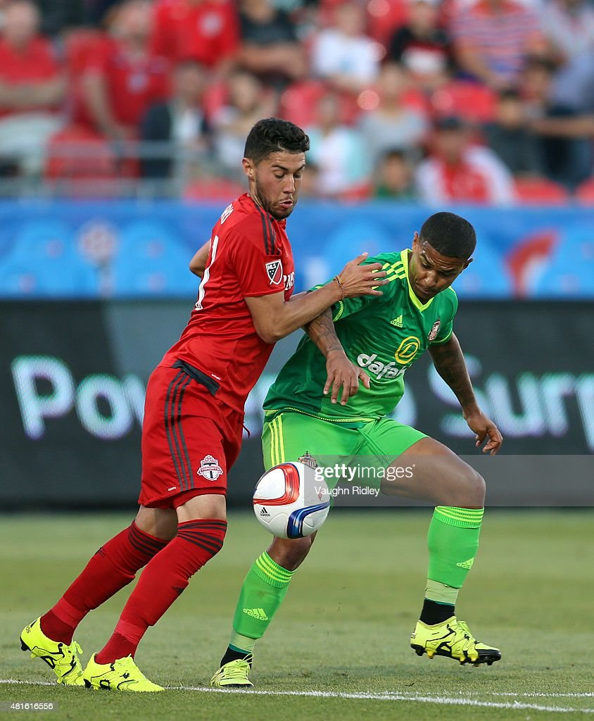 Jonathan Osorio #21 of Toronto FC and Liam Briscutt #4 of Sunderland AFC battle for the ball during a friendly match at BMO Field on July 22, 2015 in Toronto, Ontario, Canada.