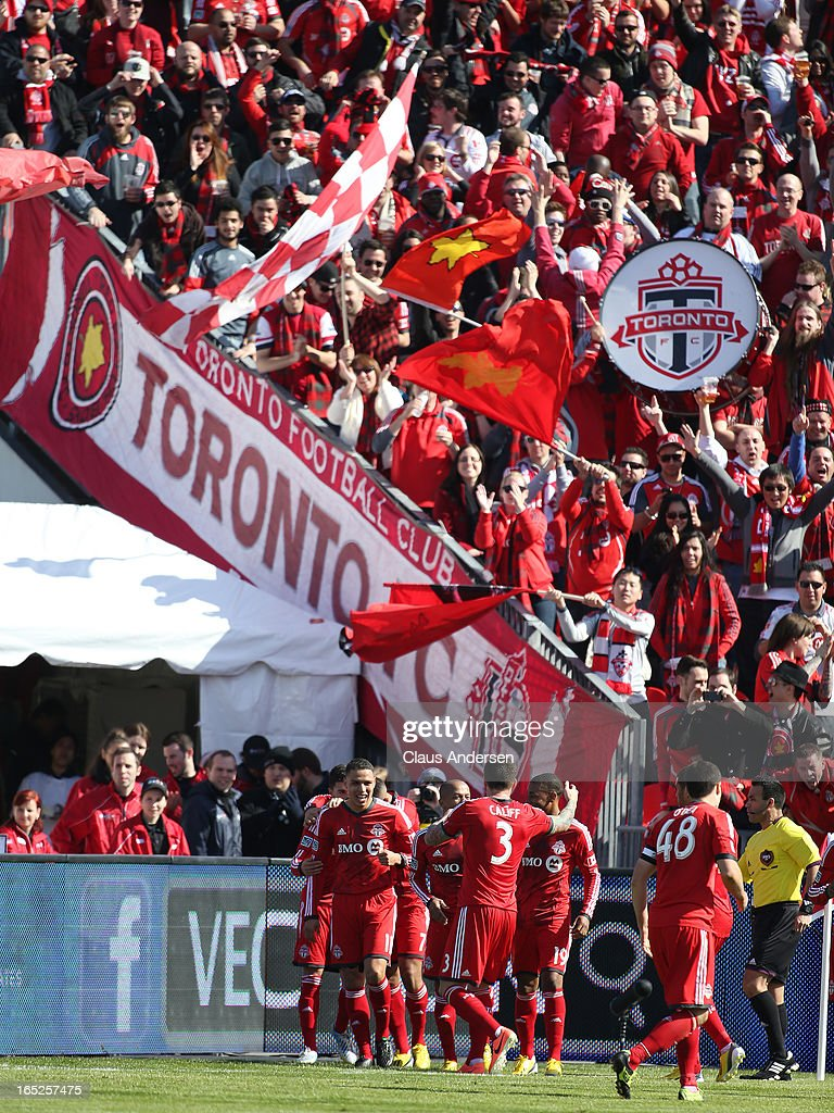 Jonathan Osorio #21 of Toronto FC receives congratulations on his goal in an MLS game against the LA Galaxy on March 30, 2013 at BMO field in Toronto, Ontario, Canada. The LA Galaxy and the Toronto FC played to a 2-2 tie.