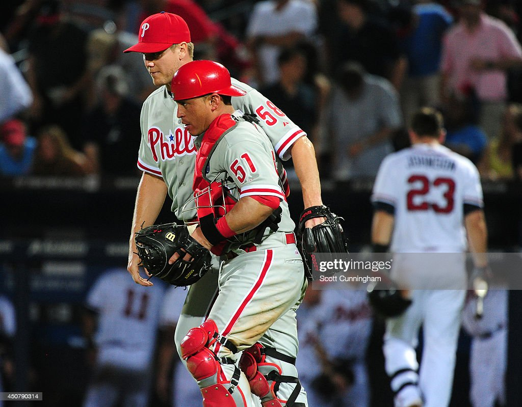 Jonathan Papelbon #58 and Carlos Ruiz #51 of the Philadelphia Phillies celebrate after defeating the Atlanta Braves at Turner Field on June 17, 2014 in Atlanta, Georgia.