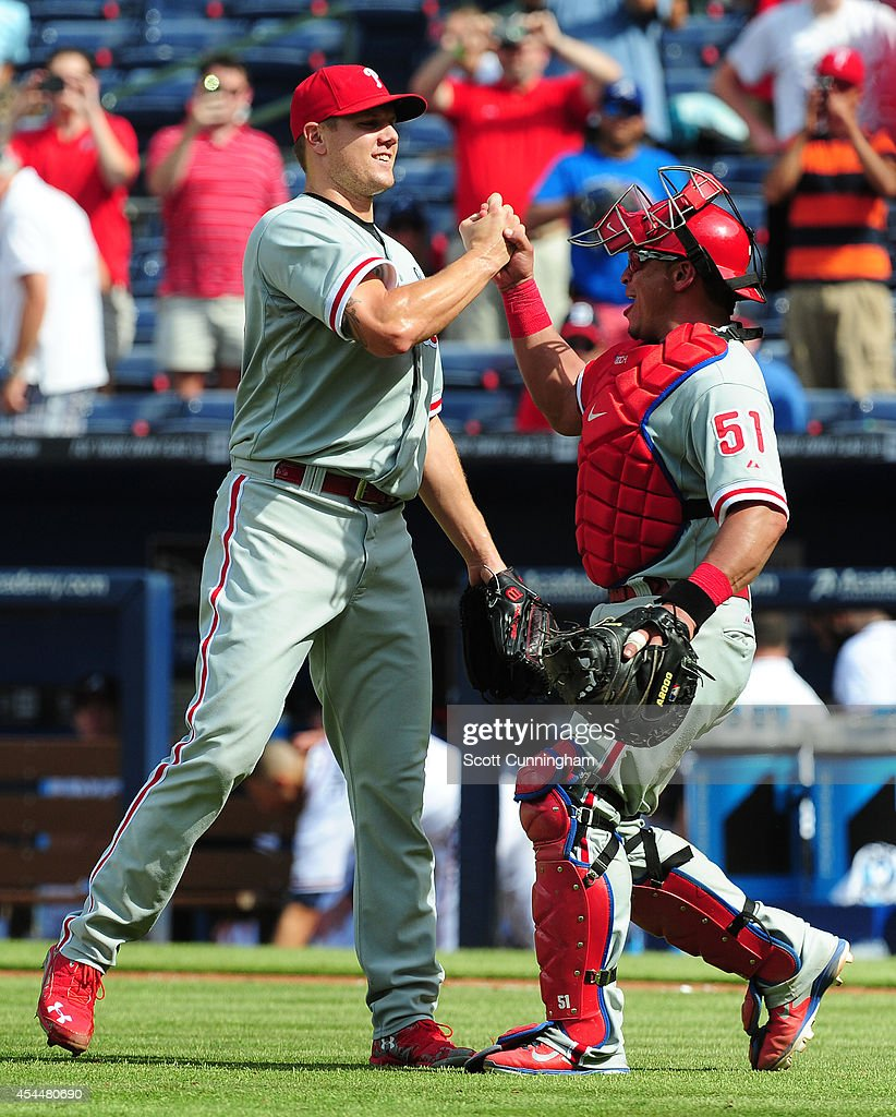 Jonathan Papelbon and Carlos Ruiz of the Philadelphia Phillies celebrate after completing a four pitcher nohitter against the Atlanta Braves at...
