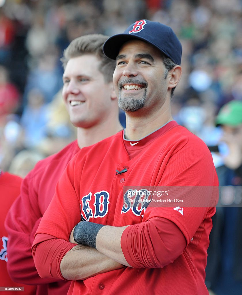 Jonathan Papelbon and Mike Lowell of the Boston Red Sox smile during a pregame ceremony honoring Lowell before a game against the New York Yankees on...