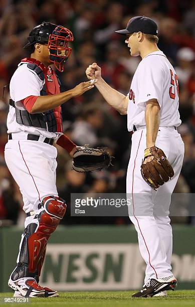 Jonathan Papelbon and Victor Martinez of the Boston Red Sox celebrate the win over the New York Yankees on April 4 2010 during Opening Night at...