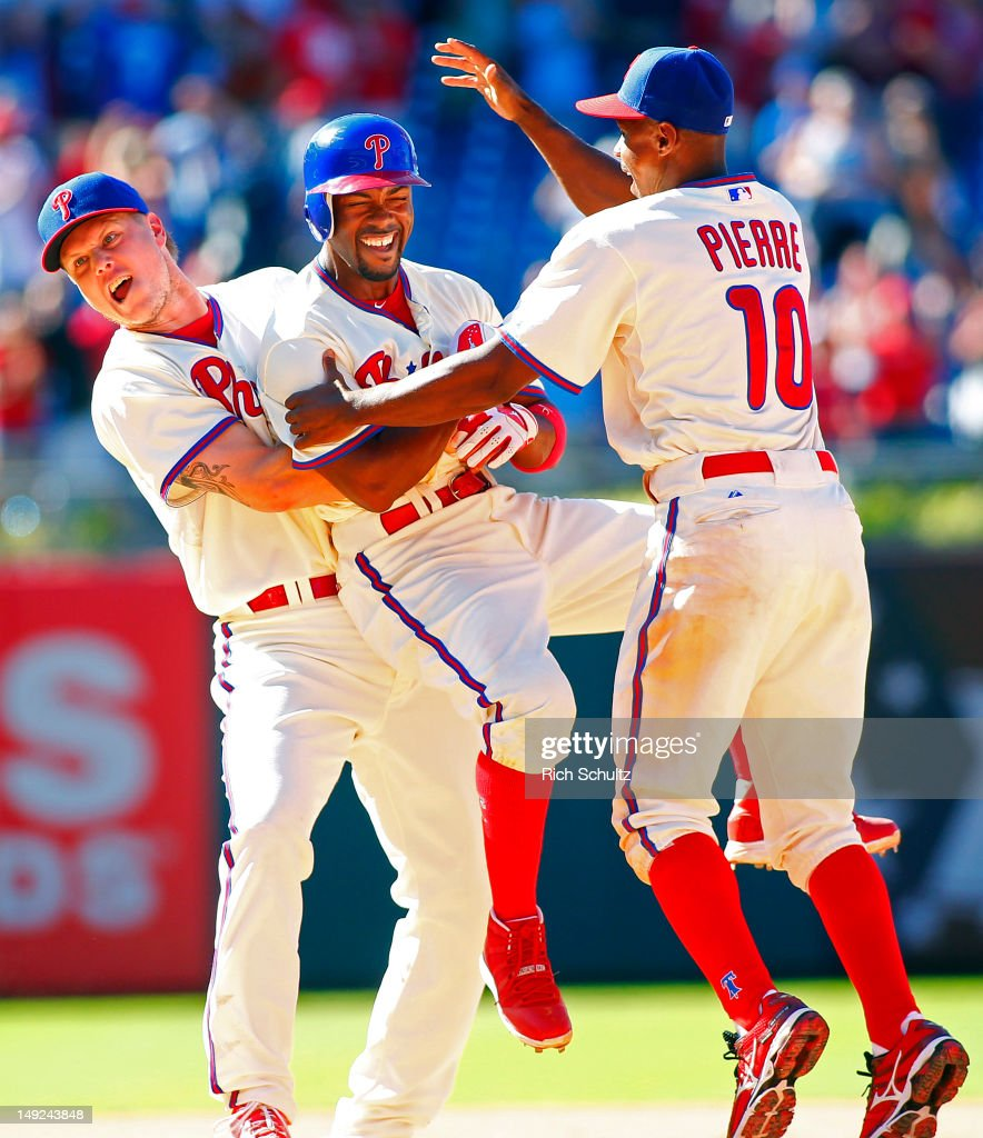<a gi-track='captionPersonalityLinkClicked' href=/galleries/search?phrase=Jonathan+Papelbon&family=editorial&specificpeople=453535 ng-click='$event.stopPropagation()'>Jonathan Papelbon</a> #58 <a gi-track='captionPersonalityLinkClicked' href=/galleries/search?phrase=Juan+Pierre&family=editorial&specificpeople=202961 ng-click='$event.stopPropagation()'>Juan Pierre</a> #10 of the Philadelphia Phillies mob teammate <a gi-track='captionPersonalityLinkClicked' href=/galleries/search?phrase=Jimmy+Rollins&family=editorial&specificpeople=204478 ng-click='$event.stopPropagation()'>Jimmy Rollins</a> #11 after Rollins singled in Mike Fontenot #18 (not pictured) with the game winning run in the 10th inning of closer Francisco Rodriguez #57 of the Milwaukee Brewers during a MLB baseball game on July 25, 2012 at Citizens Bank Park in Philadelphia, Pennsylvania. The Phillies defeated the Brewers 7-6.