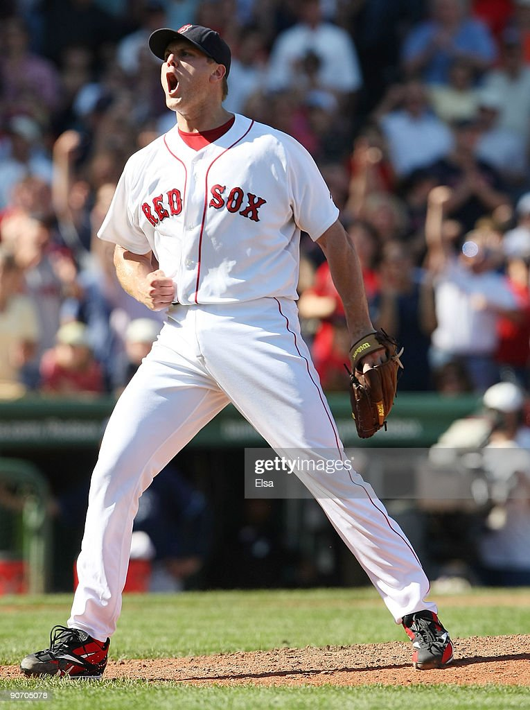 Jonathan Papelbon of the Boston Red Sox celebrates the final out against the Tampa Bay Rays on September 13 2009 at Fenway Park in Boston...