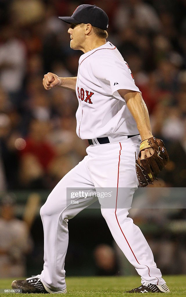 Jonathan Papelbon of the Boston Red Sox celebrates the last out and the win over the New York Yankees on April 4 2010 during Opening Night at Fenway...