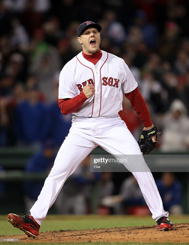 Jonathan Papelbon of the Boston Red Sox celebrates the win over the Chicago Cubs on May 22 2011 at Fenway Park in Boston Massachusetts Before this...
