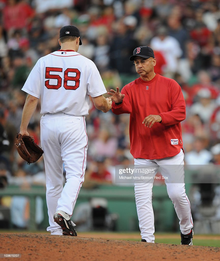 Jonathan Papelbon #58 of the Boston Red Sox hands the ball over to manager Terry Francona #47 after being lifted in the ninth inning of a game against the Chicago White Sox on September 5, 2010 at Fenway Park in Boston, Massachusetts.