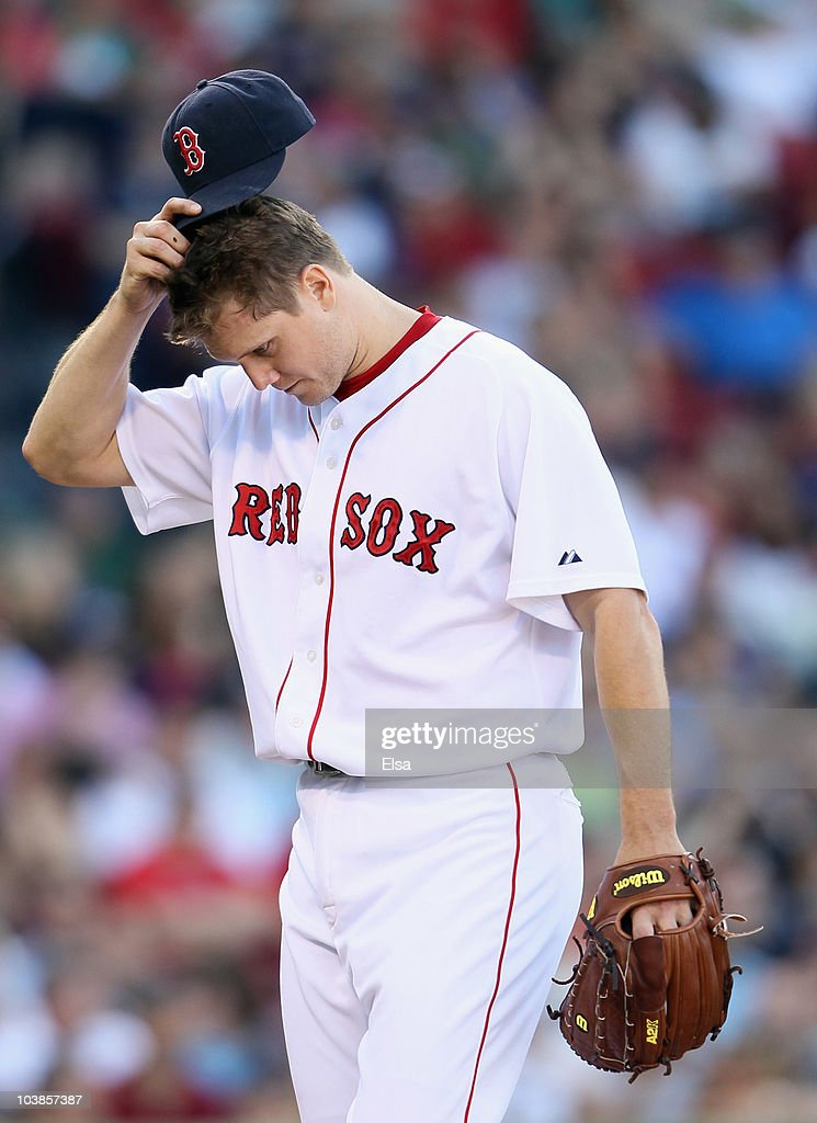 Jonathan Papelbon #58 of the Boston Red Sox heads for the dugout after he is pulled in the ninth inning against the Chicago White Sox on September 5, 2010 at Fenway Park in Boston, Massachusetts.