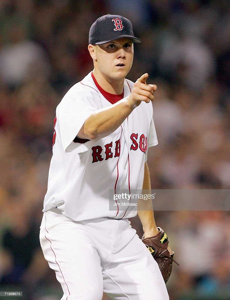 Jonathan Papelbon of the Boston Red Sox point towards first base against the New York Mets on June 29 2006 at Fenway Park in Boston Massachusetts