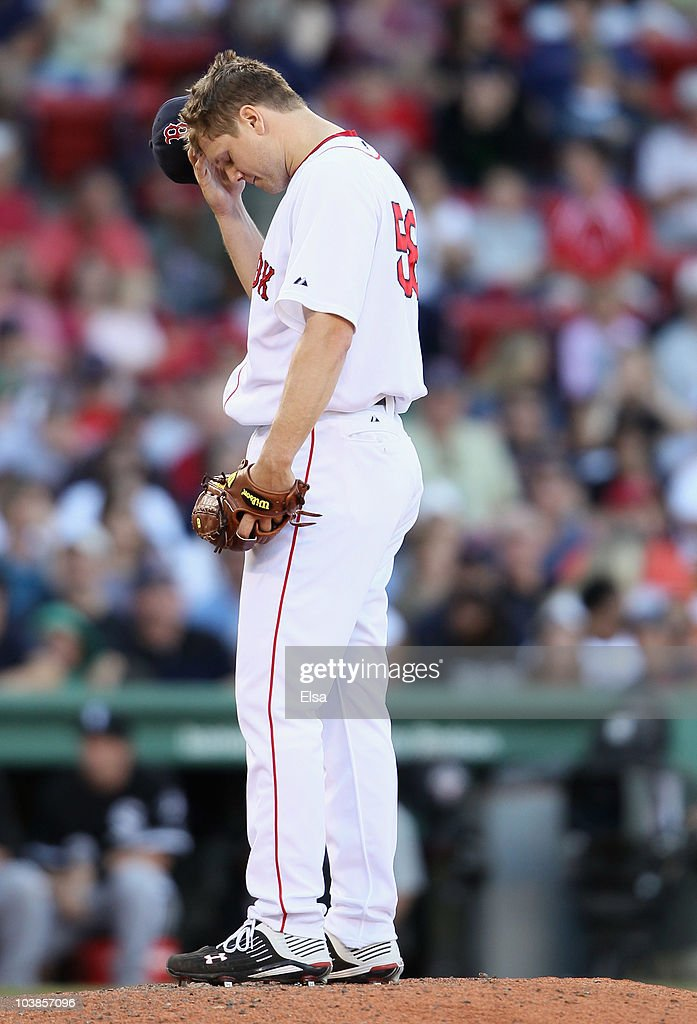 Jonathan Papelbon of the Boston Red Sox reacts after giving up 2 runs and walking another batter in the ninth inning against the Chicago White Sox on...