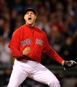 Jonathan Papelbon of the Boston Red Sox reacts after striking out Evan Longoria of the Tampa Bay Rays in the ninth inning to earn a 43 win at Fenway...