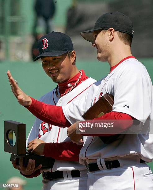 Jonathan Papelbon of the Boston Red Sox shows off his 2007 World Series ring to Hideki Okajima of Japan during pregame ceremonies before the Red Sox...