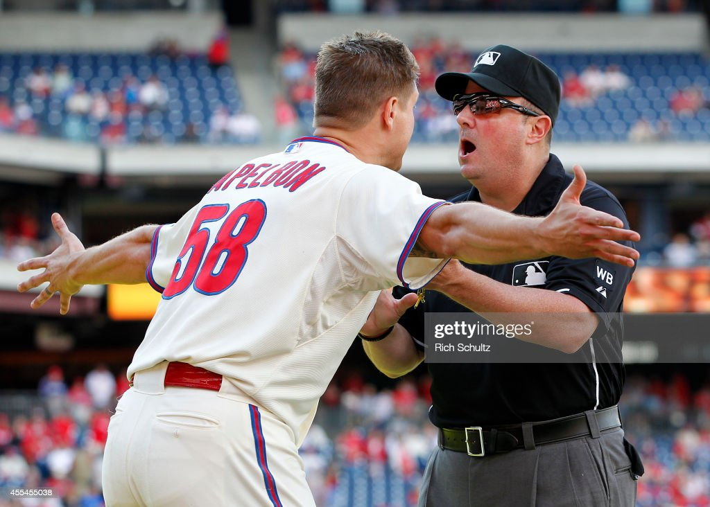 Jonathan Papelbon of the Philadelphia Phillies argues with umpire Marty Foster after Papelbon was ejected from the game after making an obscene...