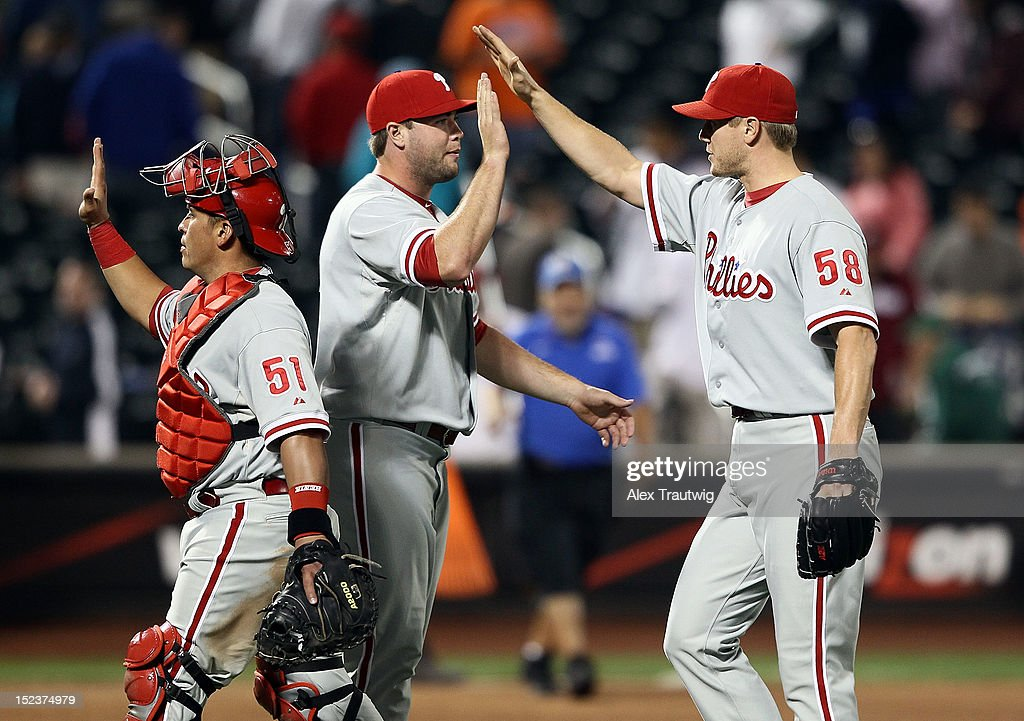 <a gi-track='captionPersonalityLinkClicked' href=/galleries/search?phrase=Jonathan+Papelbon&family=editorial&specificpeople=453535 ng-click='$event.stopPropagation()'>Jonathan Papelbon</a> #58 of the Philadelphia Phillies (R) celebrates with teammates after defeating the New York Mets 3-2 at Citi Field on September 19, 2012 in the Flushing neighborhood of the Queens borough of New York City.